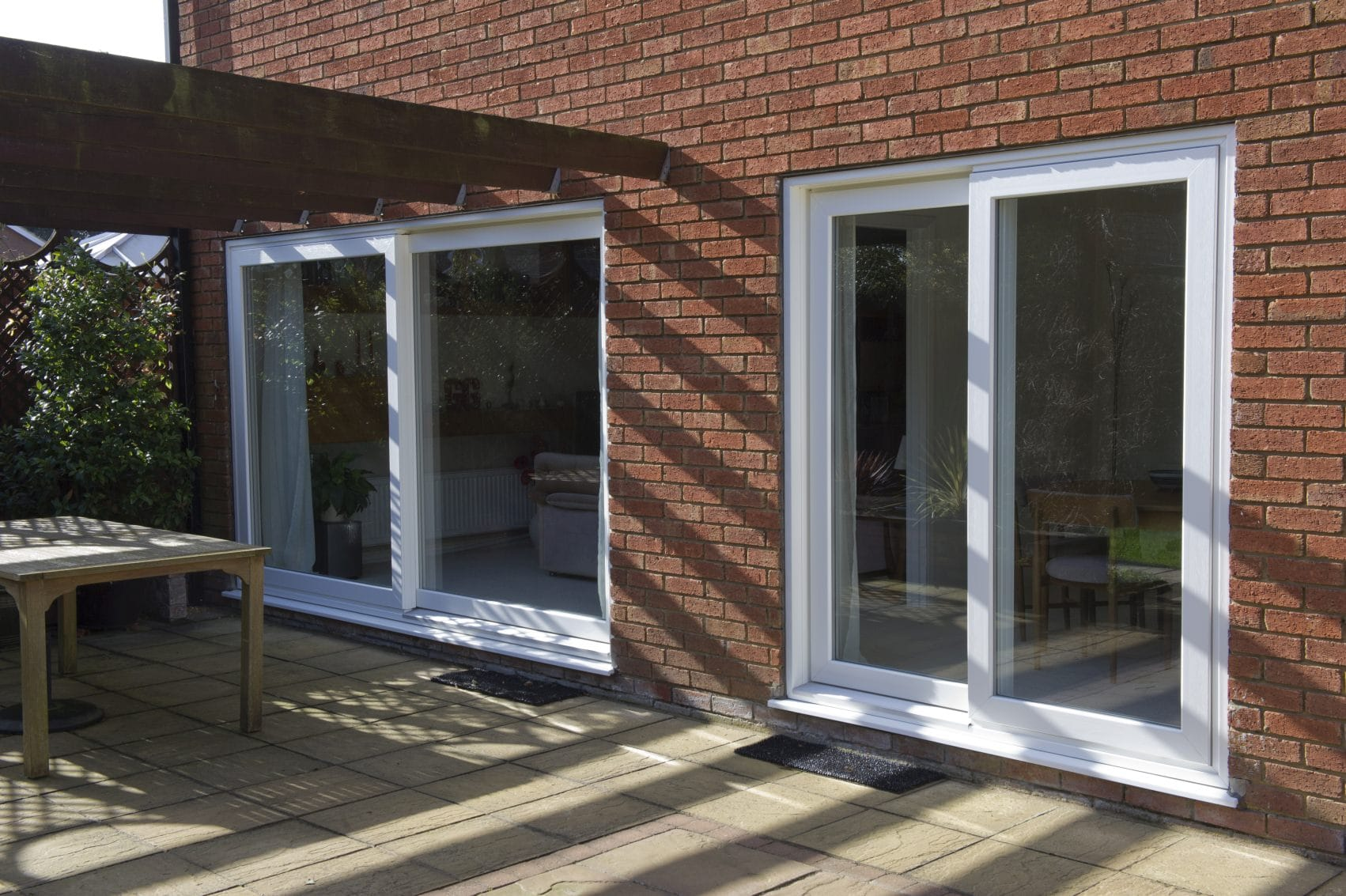 Patio doors coral windows for Back door sliding door